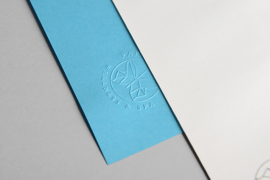 Logo and stationery with coloured paper and blind deboss detail designed by Sciencewerk for Indonesian spa Papillon Blu