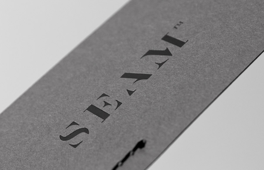 Logo and business card with black block foil detail designed by For Brands for fashion brand Seam