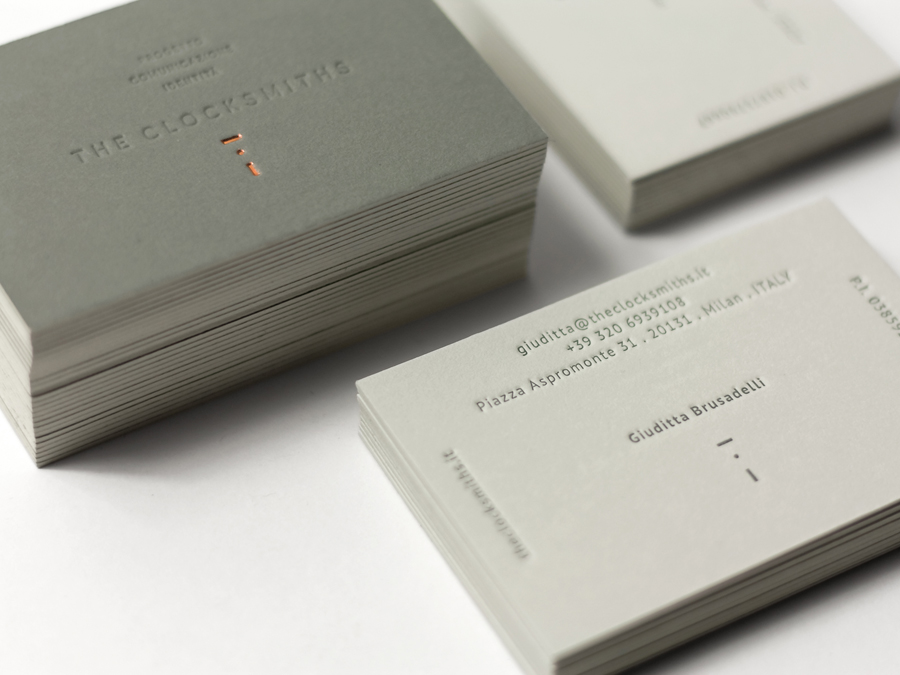 Copper foil and blind deboss business card designed by The Clocksmiths