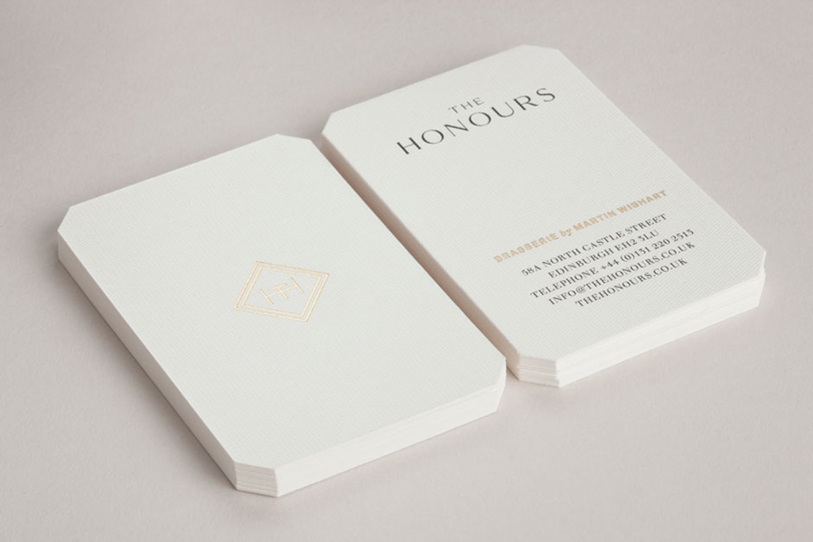 Logo and print work with gold foil and embossed paper detail for brasserie The Honours designed by Touch