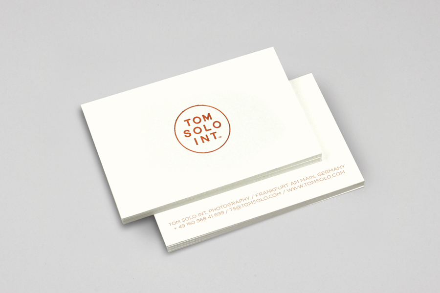 Logo and business card with debossed copper foil detail for photographer Tom Solo designed by Mash