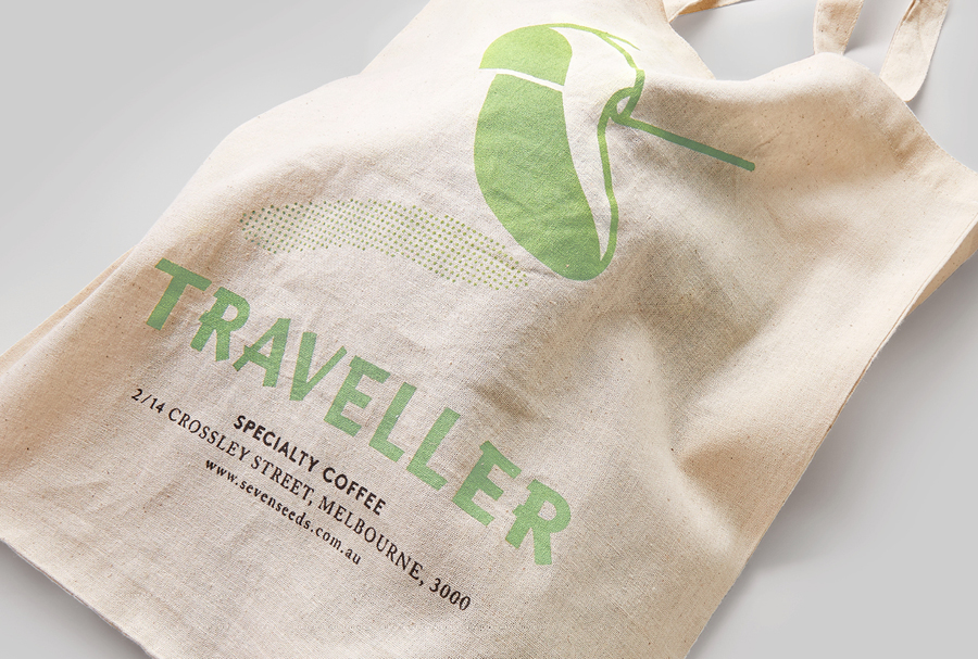 Logo and logotype as a print detail across a tote bag for Melbourne espresso bar Traveller designed by The Company You Keep