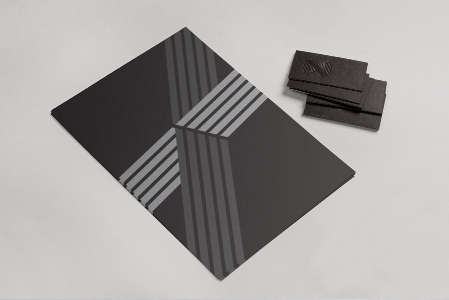 Logo, folder and duplex business card with black foil detail for web developer Zann St Pierre created by ThoughtAssembly