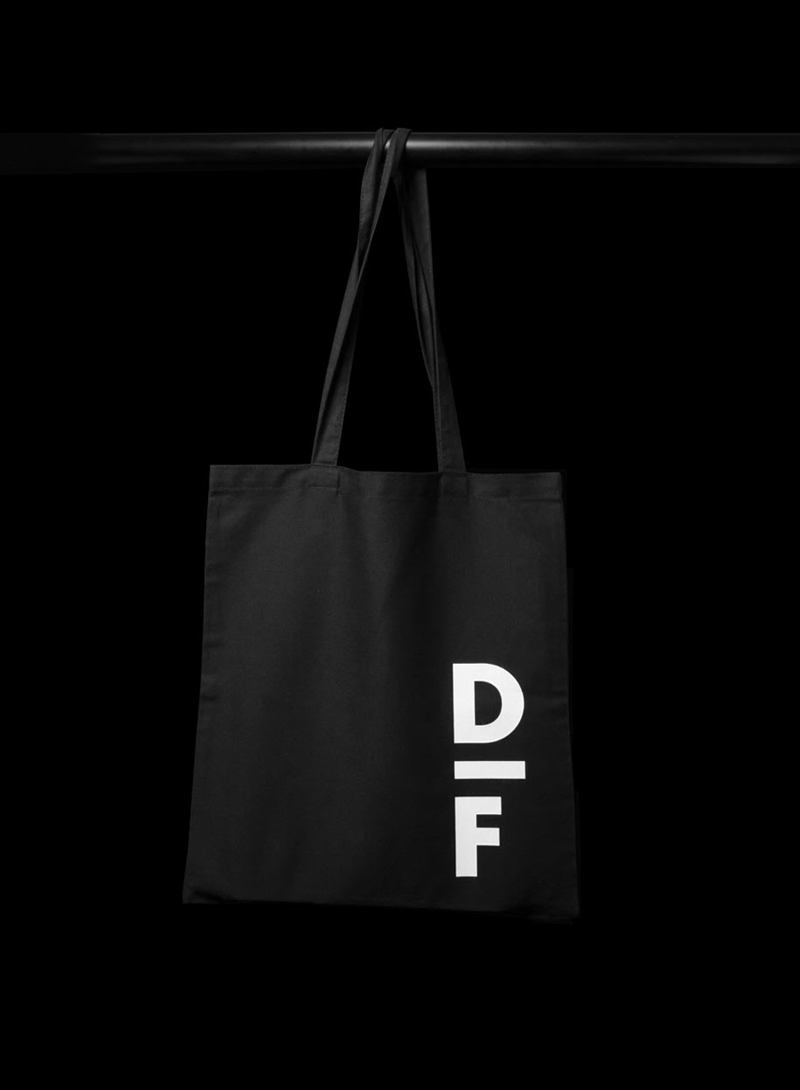 Logo and tote bag with white ink detail created by Spin for creative exchange and artistic development network Delfina Foundation