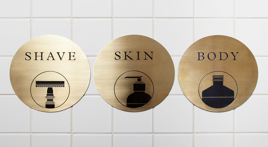 Acid-etched brass signage by ThoughtAssembly for male grooming business Men's Biz