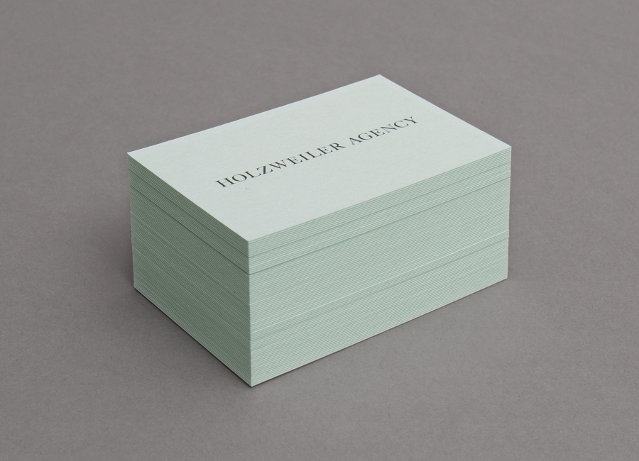 Logo and coloured board business card designed by Bielke+Yang for contemporary fashion distributor Holzweiler