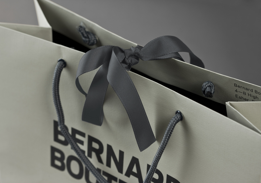 Logo and ribbon tied bags for award-winning fashion store Bernard Boutique designed by Bunch