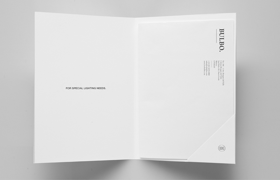 Logo and folder with silver foil detail for high-end boutique lighting shop and interior planning service Bulbo designed by Anagrama