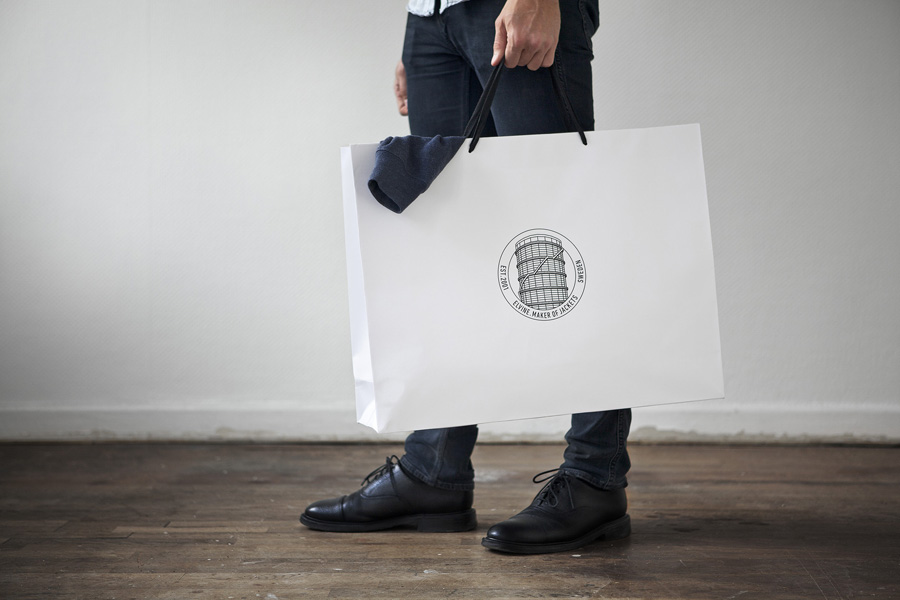 Logo and shopping bag for Swedish clothing brand Elvine designed by Lundgren+Lindqvist