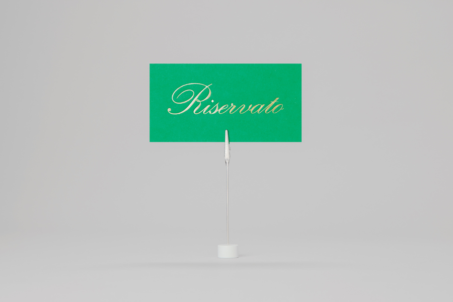 Reservation card with green and gold foil print finish for Monterrey-based traditional Italian restaurant Iannilli designed by Savvy