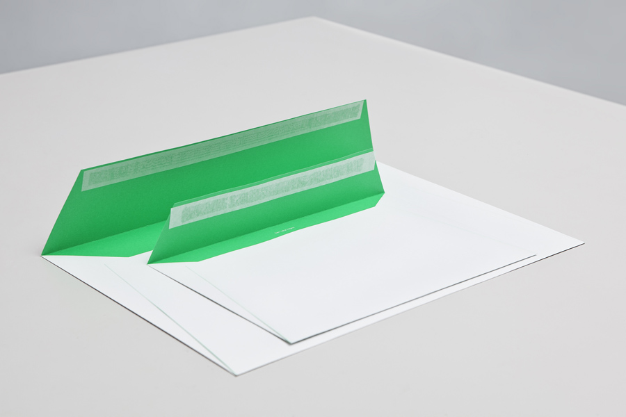 Envelopes with green fluorescent ink detail designed by Lundgren+Lindqvist for Swedish print production and project management company MediaCreator