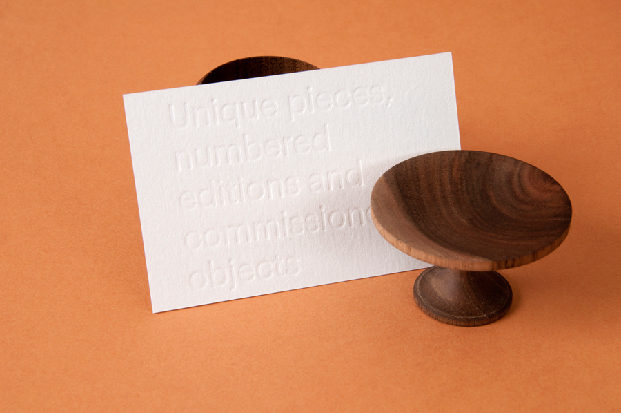Tag with blind embossed sans-serif typography designed by P.A.R for Numbered by Martín Azúa