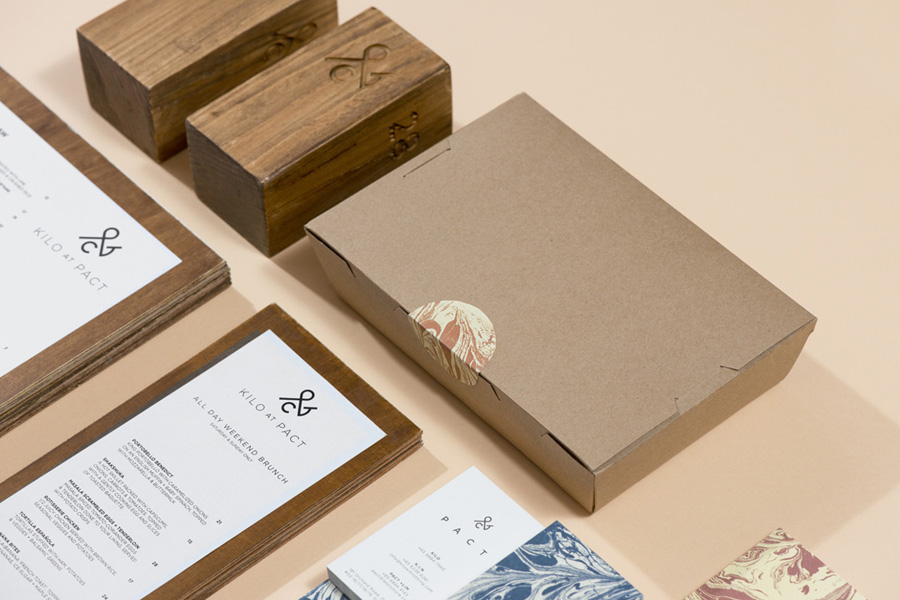 Logo and print with marble pattern detail designed by Acre for co-branded retail partnership Pact