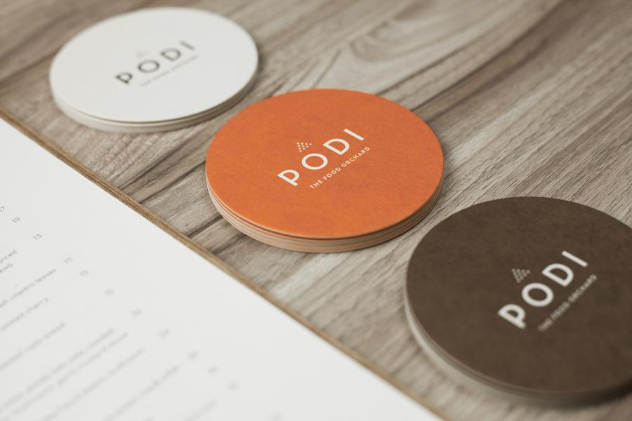 Logotype and coasters designed by Bravo Company for Singapore-based organic restaurant Podi