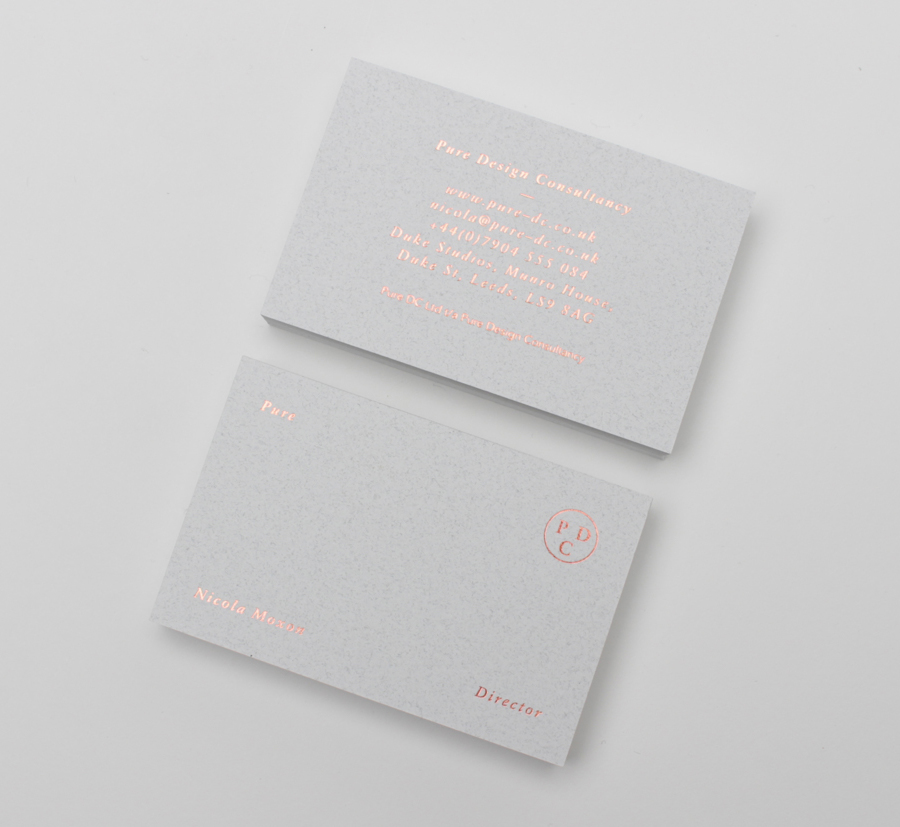 Business cards with copper foil and alabaster paper detail by Passport for interior design consultancy Pure