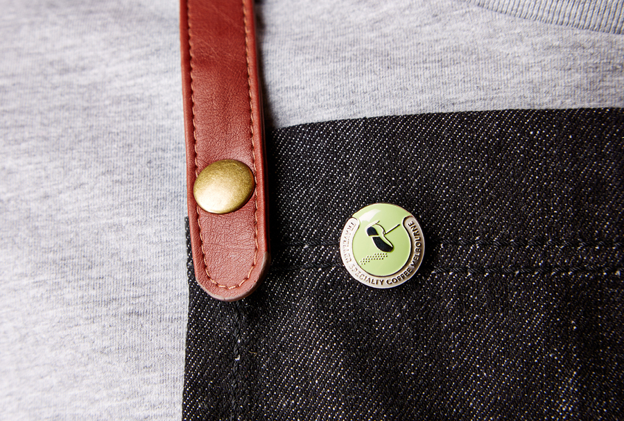 Logo as a pin badge for Melbourne espresso bar Traveller designed by The Company You Keep