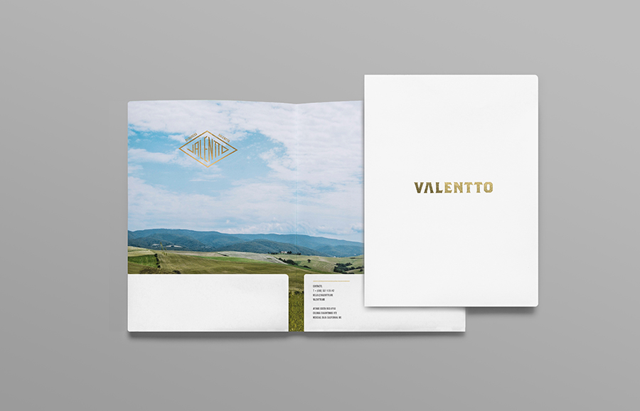 Logo and folder with gold foil and photographic landscape detail designed by Anagrama for olive oil brand Valentto