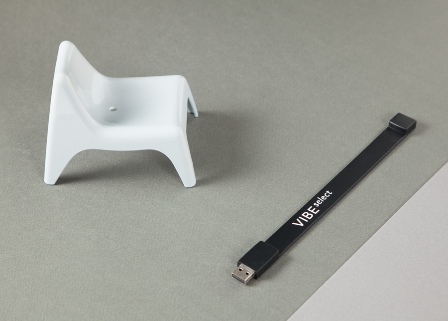 Sans-serif logotype and wristband USB dongle for architectural firm Vibe Select designed by Studio Constantine