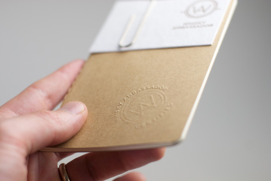 Logo, blind embossed note book and business card with copper print detail designed by O Street for Whisky Ambassador