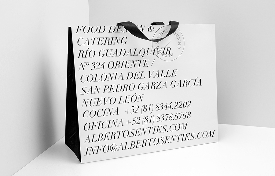 Bag with silver foil detail for Alberto Senties Catering designed by Anagrama