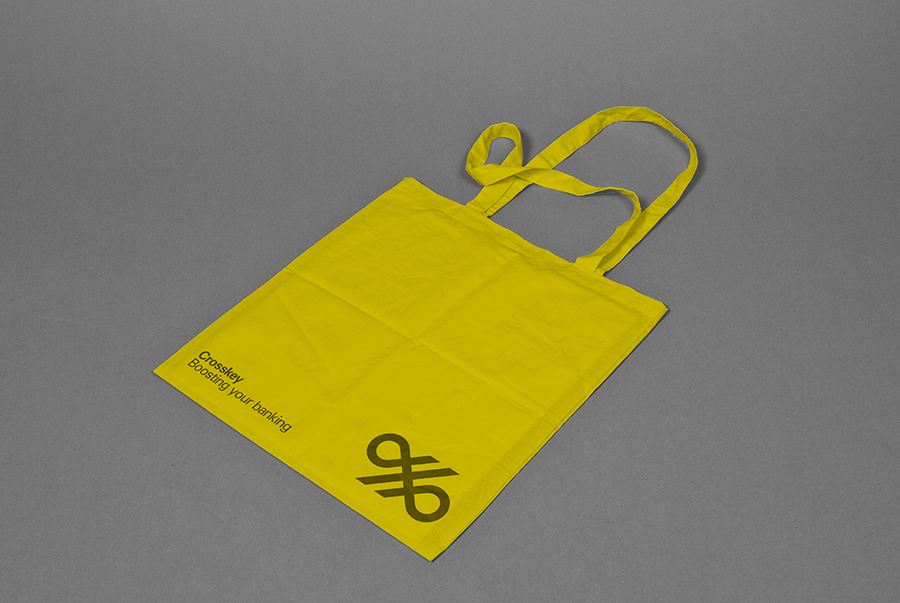 Logo and yellow tote bag for banking systems and solutions firm Crosskey designed by Kurppa Hosk