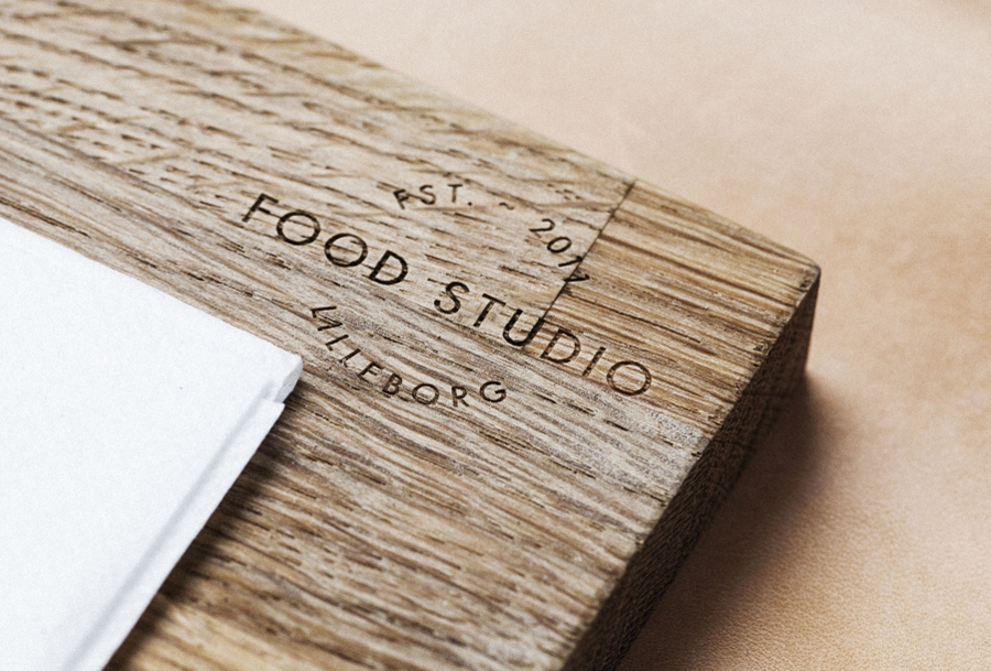 Logo design debossed into a wooden surface by Bielke+Yang for Food Studio