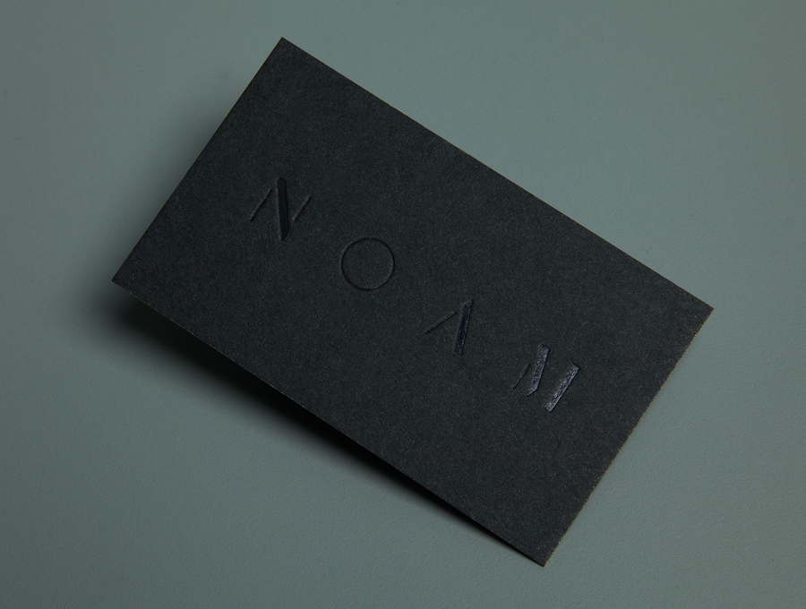Logo and business card with black deboss foil detail created by Graphical House for interior design consultancy Noam