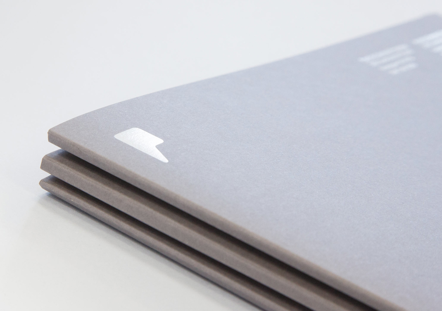 Logo and folders with grey board and white ink detail designed by Freytag Anderson for Partick Dental featured on BPO