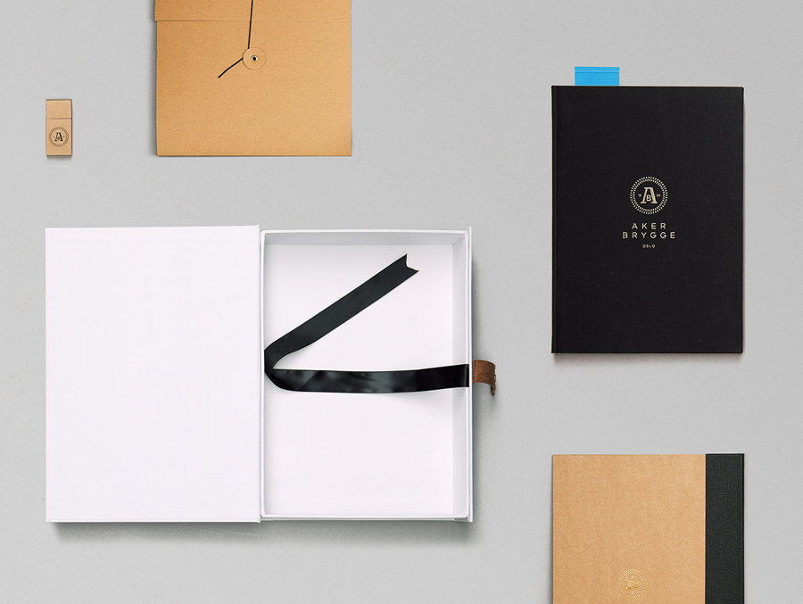Logo, stationery and accessory design with gold foil detail designed by Bleed for the redevelopment of Oslo waterside district Aker Brygge
