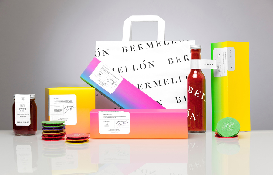Packaging range with neon inks, tradition typography with stencil cuts and sticker detail for confectionery shop Bermellón designed by Anagrama