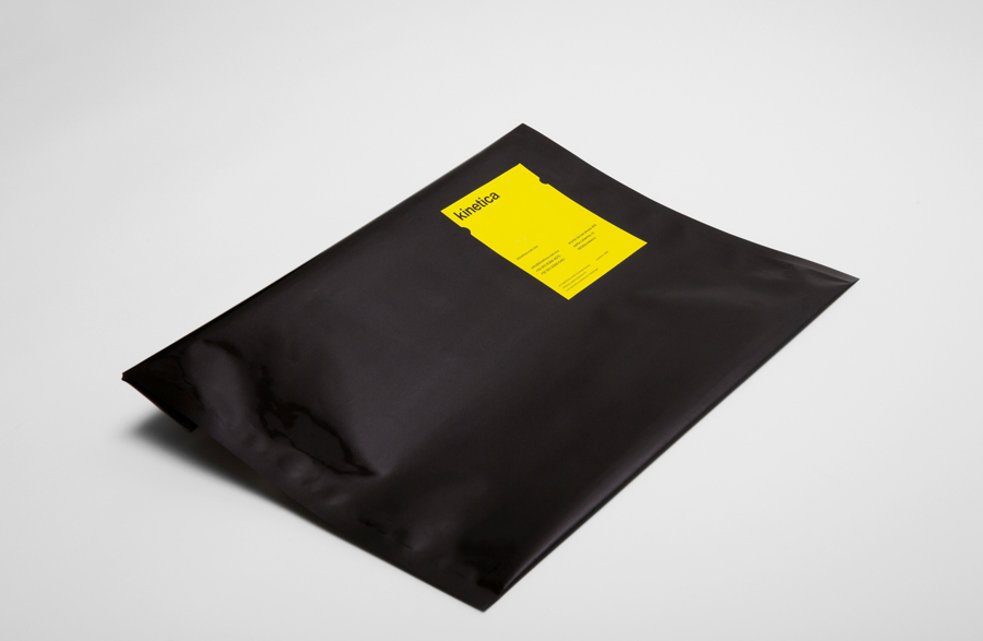 Logotype and envelope with die cut yellow sticker designed by Face for industrial design studio Kinetica