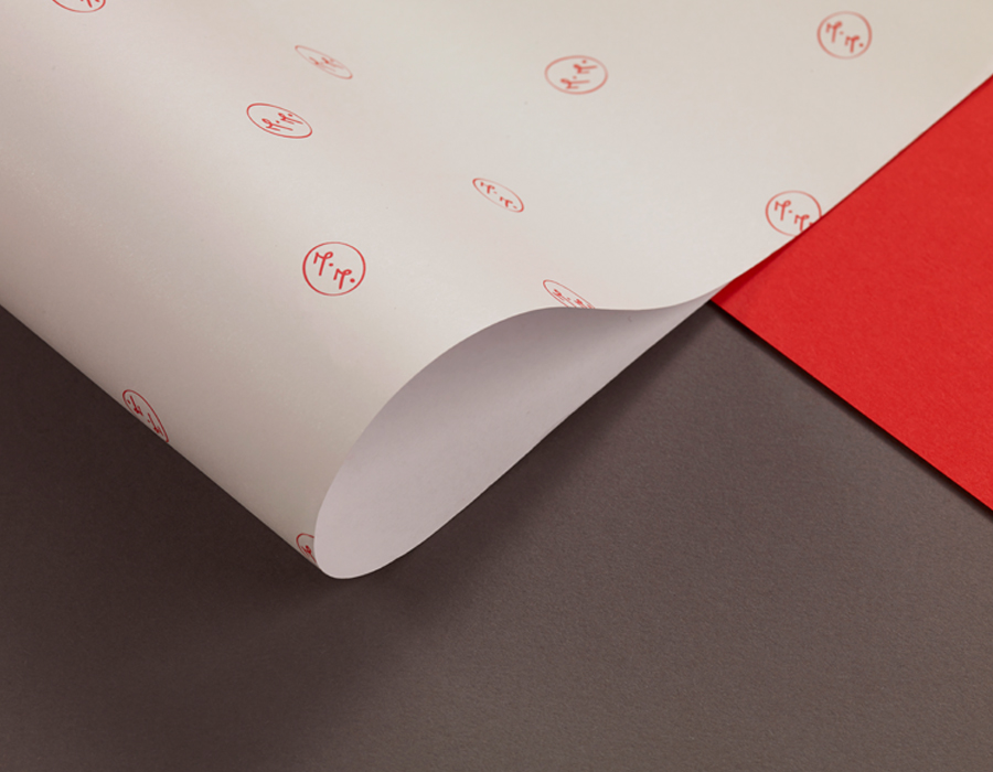 Print with a red spot colour monogram detail designed by ico for jewellery brand Mark Milton