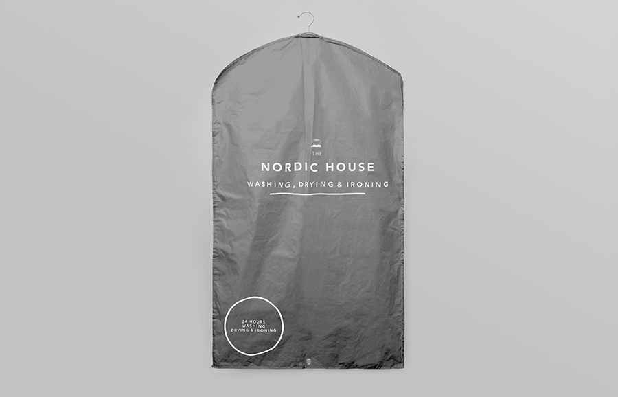 Logo and clothes cover designed by Anagrama for dry cleaning shop Nordic House