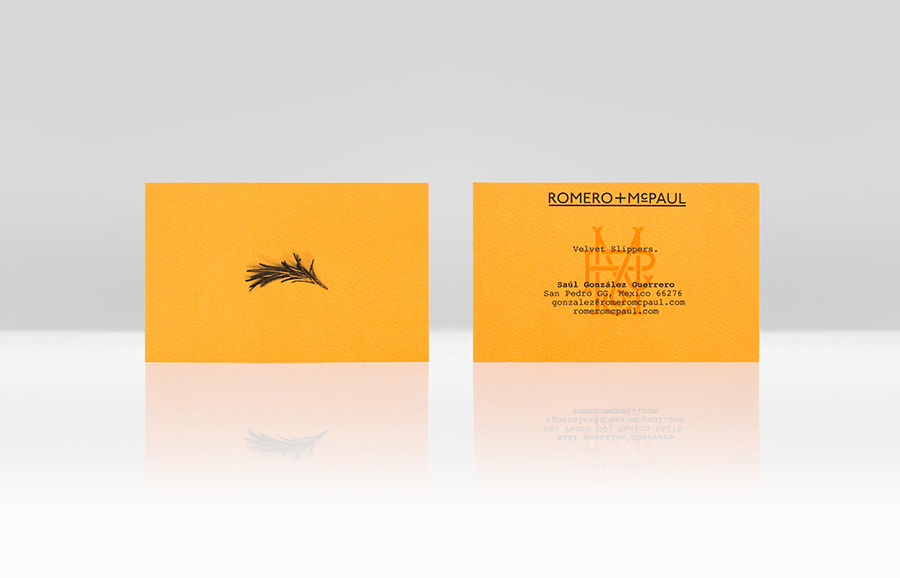 Logo and orange business card with an embossed surface finish created by Anagrama for luxury slipper brand Romero+McPaul