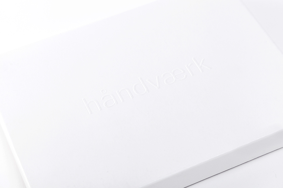 Packaging with blind emboss logotype detail designed by Savvy for fashion brand Handvaerk