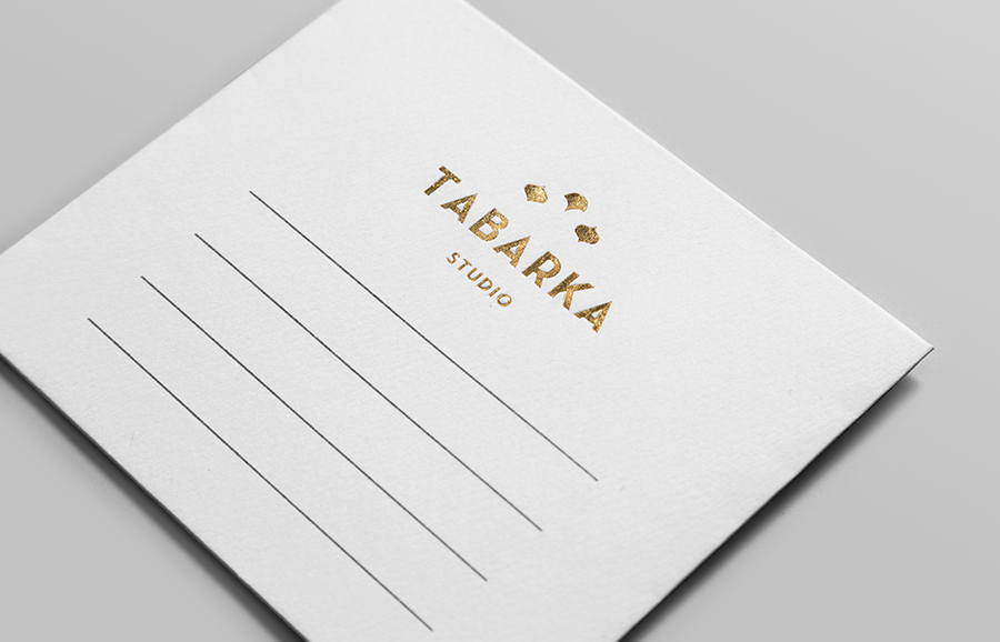 Logo and stationery with gold block foil detail designed by Anagrama for handcrafted terracotta tile specialist Tabarka Studio