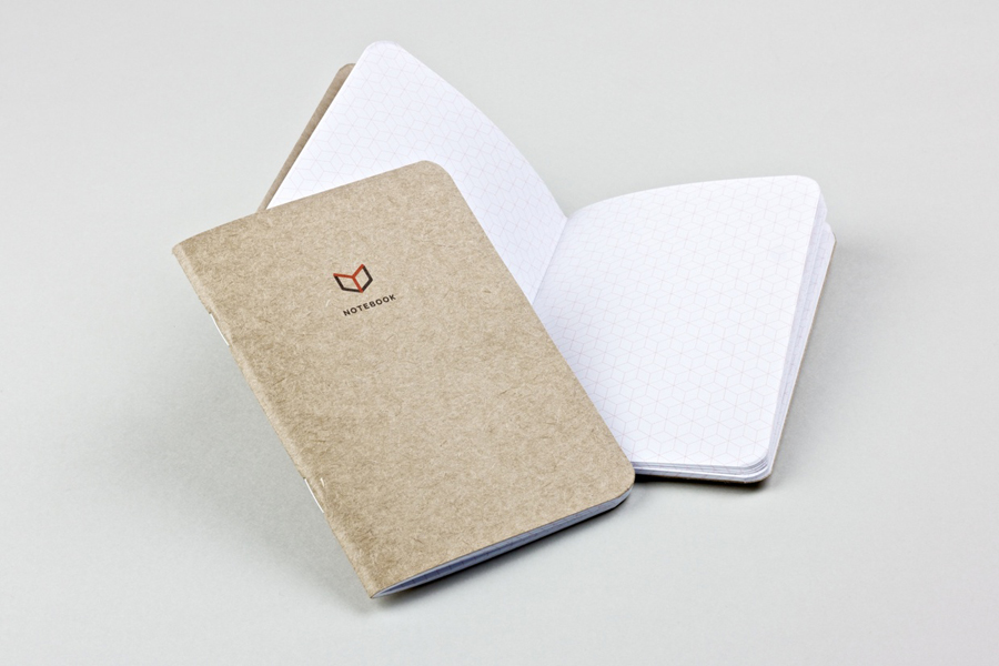 Notebook with icon and logo detail for The Chain Reaction Project designed by Bravo Company