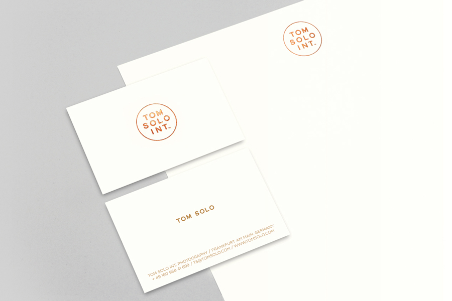 Logo, business card and letterhead with copper foil detail for photographer Tom Solo designed by Mash