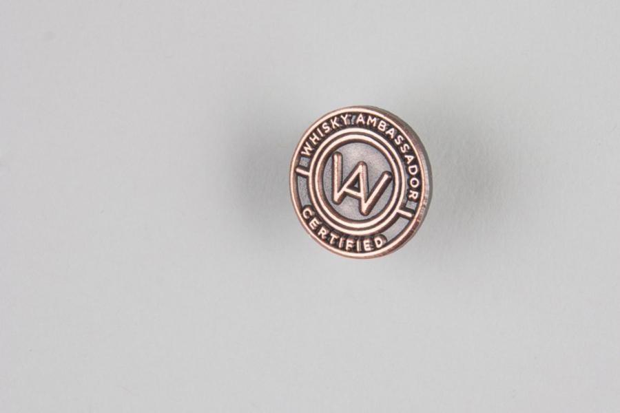 Bronze logo pin designed by O Street for Whisky Ambassador