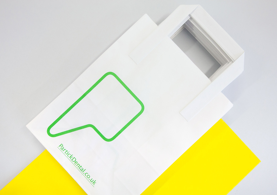 Logo and print with yellow paper and fluorescent green print finish designed by Freytag Anderson for Partick Dental featured on BPO