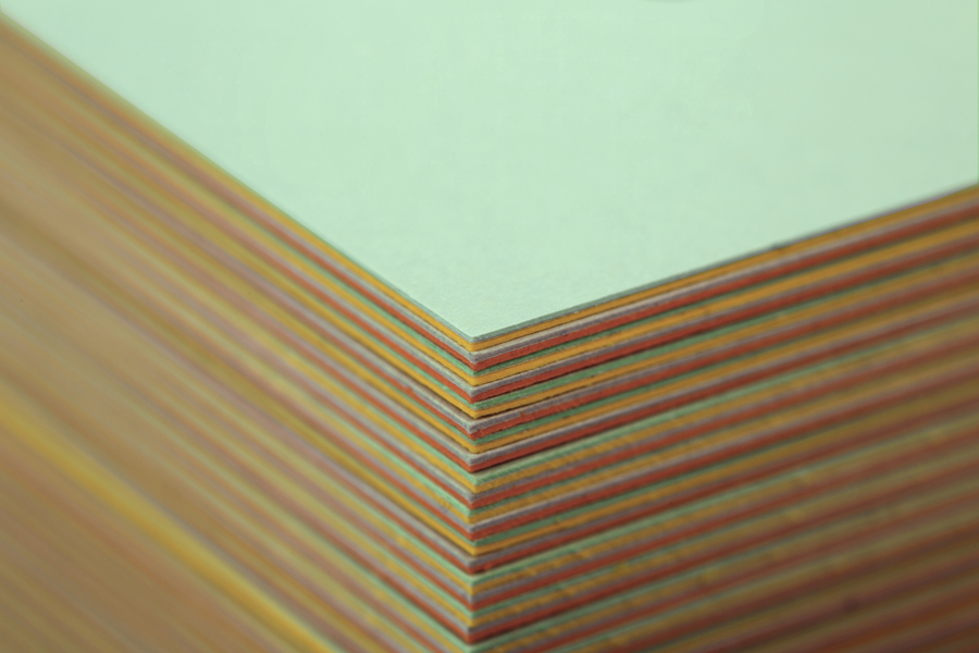 Business card constructed from coloured board using a marquetry technique designed by Bunch for digital design studio Sebazzo