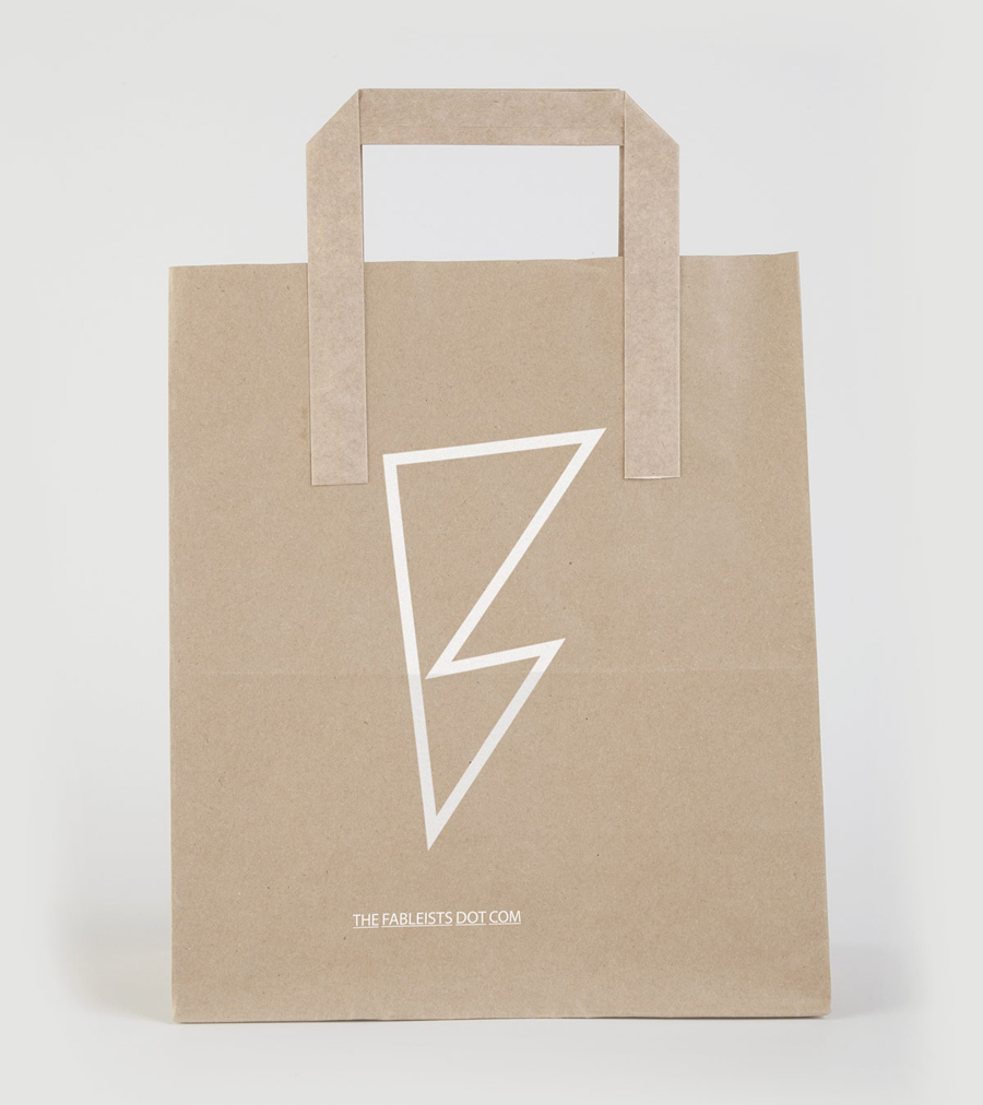 Logo and uncoated, unbleached bag with white ink finish for children's fashion brand The Fableists designed by Freytag Anderson featured on BPO