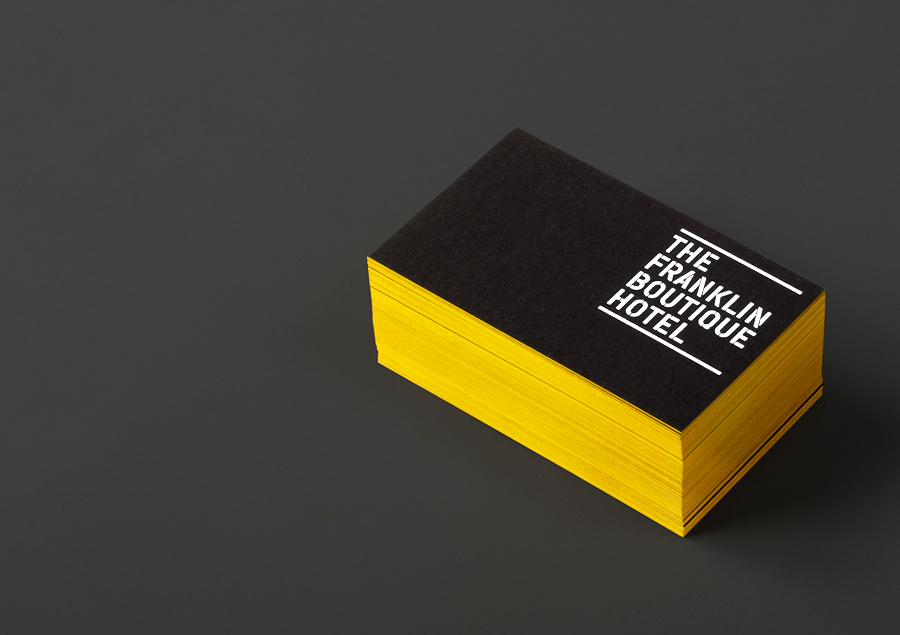 Logo and business cards with yellow edge painted detail and white foil designed by Band for The Franklin Boutique Hotel
