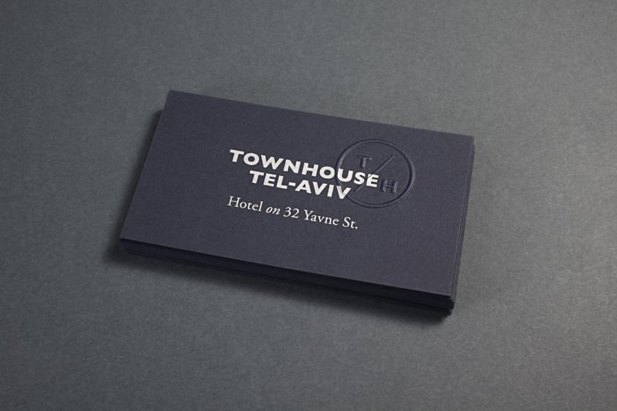 Logo and business card with blind emboss monogram detail for Tel Aviv hotel Townhouse designed by Koniak