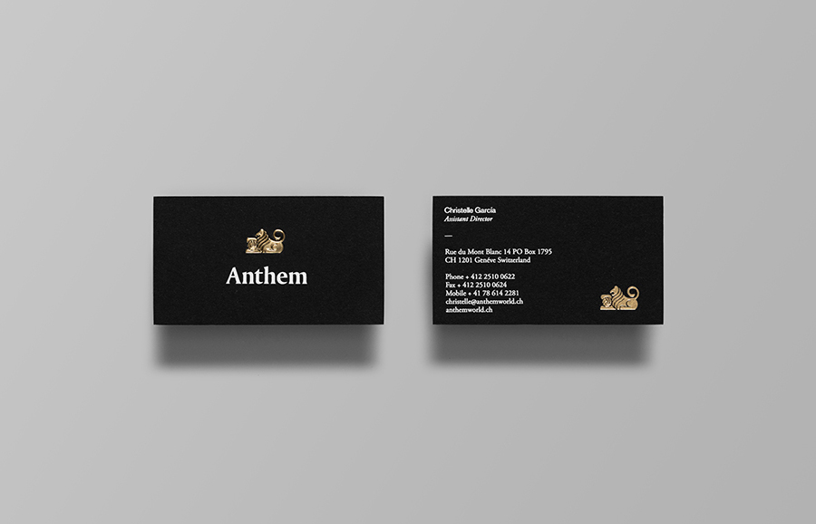 Logo and business card with embossed gold foil and white foil detail by Anagrama for football scout and transfer business Anthem