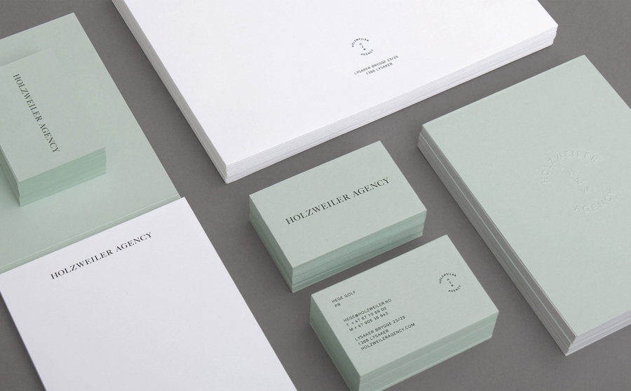 Logo and stationery with blind emboss and coloured board detail designed by Bielke+Yang for contemporary fashion distributor Holzweiler