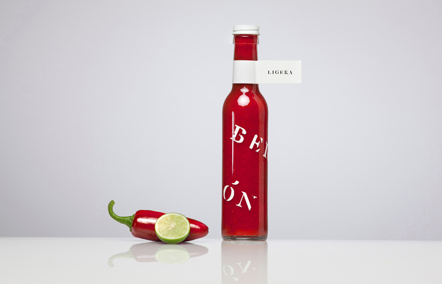Bottle with screen print and sticker detail for confectionery shop Bermellón designed by Anagrama