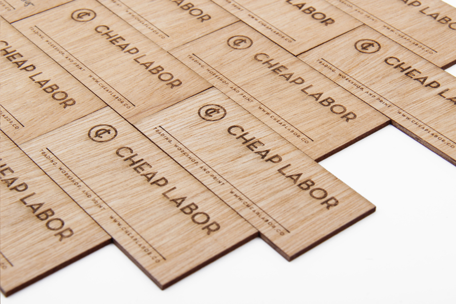 Logo and wooden business cards with heat treated detail for craft retail site Cheap Labor designed by Sciencewerk