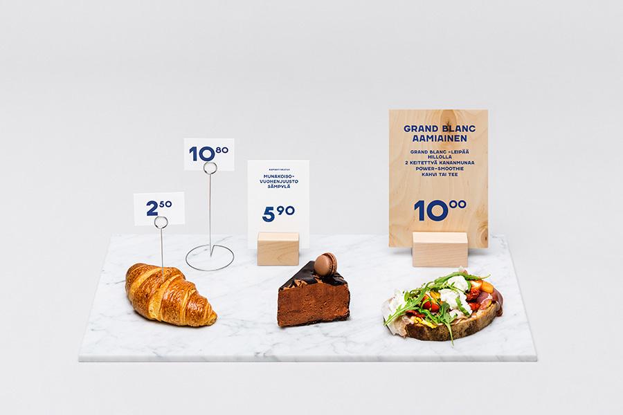 Signage for Helsinki-based Fazer Cafe designed by Kokoro & Moi