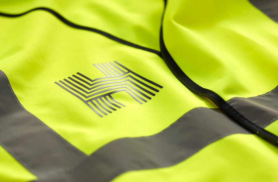 Logo on a high vis jacket designed by Spy for architecture firm Haverstock